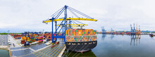 Rear View Cargo Container Ship. Business Logistic Transportation Sea Freight, Cargo Ship, Cargo Container In Deep Sea Port At Industrial Estate For Import Export Around In The World
