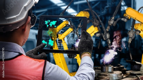 Obraz Smart industry robot arms modernization for innovative factory technology . Concept of automation manufacturing process of Industry 4.0 or 4th industrial revolution and IOT software control operation. - fototapety do salonu