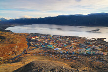 Top View Of The Arctic Settlement Of Egvekinot. Morning View Of The Northern Port Town, Bay And Mountains. Beautiful Arctic Autumn Landscape. Egvekinot, Kresta Bay, Chukotka, Siberia, Far East Russia.