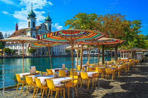 Fototapeta Street cafe on the shore of the Reuss river, Lucerne