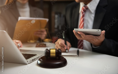 Fototapeta Business people and lawyers discussing contract papers sitting in the table at office in the morning