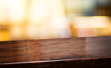 Bar Nightclub Background.Empty Diagonal Brown Wooden Table With Blur Bar Restaurant Bokeh Lights,banner Mockup Template For Display Of Product