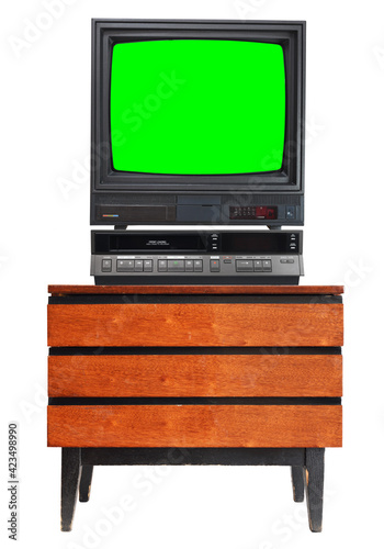 Fotografia, Obraz Old TV set with cut out green screen and VCR isolated on white, stand on vintage nightstand 1990s, 1980s