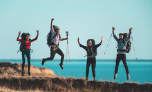 The Four Hikers Have Fun On The Sea Coast