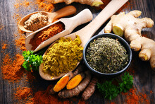 Composition With Spices On Wooden Kitchen Table