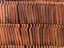 Pile Of Red Clay Tiles. Background Of Red Tiles