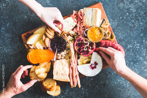 Assortment of tasty appetizers or antipasti. Charcuterie board.