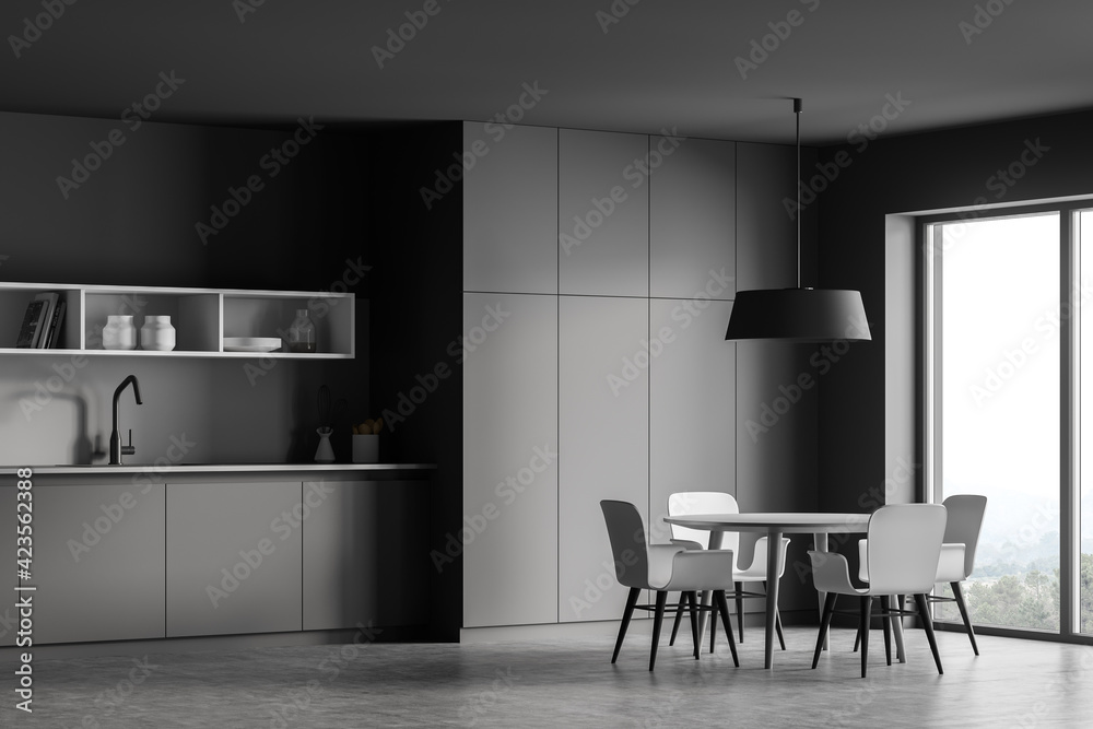 Fototapeta Grey kitchen interior with dining table and chairs near window, concrete floor