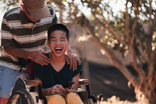 Disabled Child On Wheelchair And Father In Outdoors Park, They Have Fun With Selfie By Smart Phone, Life In The Education Age Of Special Children,Happy Disability Kid Travel In Family Holiday Concept