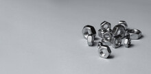 Big And Small Screw-nut. Concept. White Background.