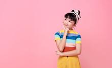Asian Child Girl Thinking Something Isolated On Pink Background.