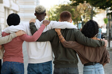 Back View Of People Making Strike On The Street, Hugging