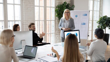 Diverse Businesspeople Applaud Clap Hands Thanking Middle-aged Successful Female Coach Or Trainer For Presentation. Happy Excited Employees Show Acknowledgement For Businesswoman At Briefing.