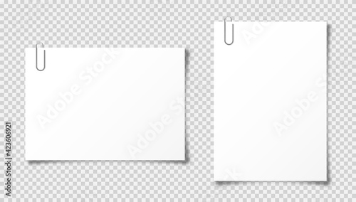 Fototapeta Realistic blank paper sheet in A4 format on transparent background. Notebook page, document with steel paper clip. Design template or mockup. Vector illustration. obraz