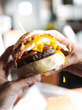 Delicious Specialty Burger With Cheddar Cheese, Tomato And Bacon