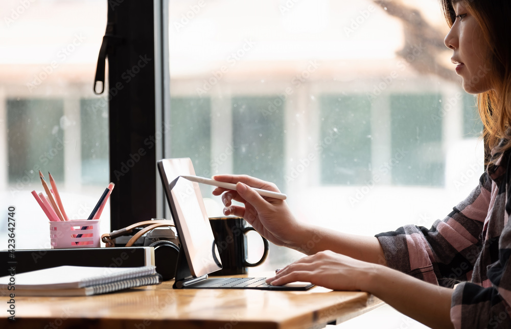 Fototapeta Asian Graphic Designer working with interactive pen display, digital Drawing tablet and Pen
