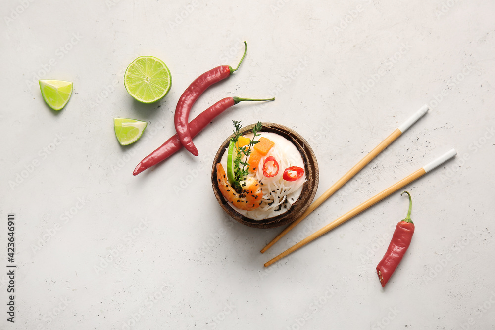 Fototapeta Bowl with Thai noodle soup on light background