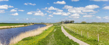 Panorama Of A Bicycle Path Along The Reitdiep River In The Landscape Near Groningen, Netherlands