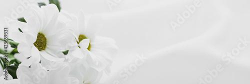 White daisy flowers on silk fabric as bridal flatlay background, wedding invitat Wallpaper Mural