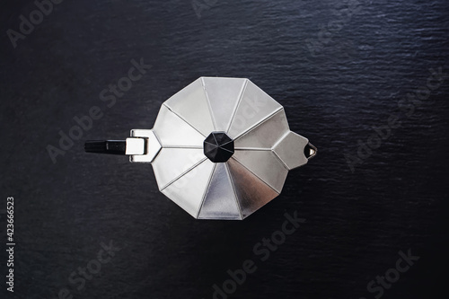 Tableau sur Toile Top view of stainless steel moka pot on black
