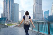 Young Beautiful Woman Enjoying The View Of Dubai Downtown.