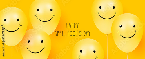 Obraz Happy April Fool's day. Yellow background with smiling balloons. Positive emotions - fototapety do salonu