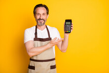 Portrait Of Attractive Cheerful Guy Store Owner Demonstrating Safe Pos Terminal Isolated Over Bright Yellow Color Background