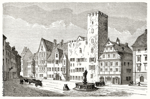 Square fronting eighteenth century buildings during everyday life in Regensburg, Germany Wallpaper Mural