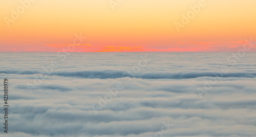 The sunset over a sea of clouds