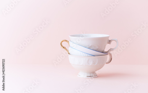 Papel de parede Stack of ceramic cups on bright background