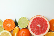 Fresh Citrus On White Background, Space For Text