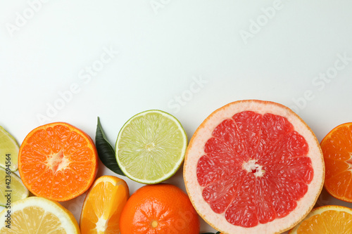 Canvas Print Fresh citrus on white background, space for text