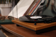 Stylish Turntable With Vinyl Disc On Table In Room, Closeup