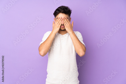 Fotografija Arabian handsome man over isolated background covering eyes by hands