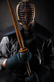 Portrait of Kendo master standing in fighting stance.
