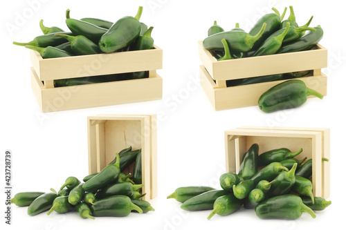 Photo fresh green peppers in a wooden box (capsicum) on a white background