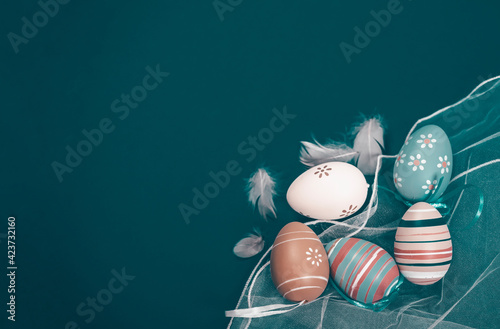 Obraz Easter background with Easter eggs. Top view with copy space. - fototapety do salonu