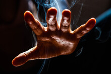 Magic Hand In  Smoke And In A Worm Striking Light