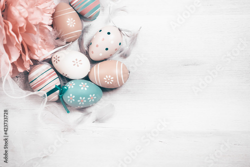 Fototapeta Easter background with Easter eggs. Top view with copy space. obraz