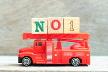 Fire Ladder Truck Hold Letter Block In Word No 1 On Wood Background