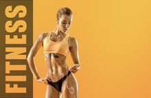 Young Fitness Woman On Yellow Background