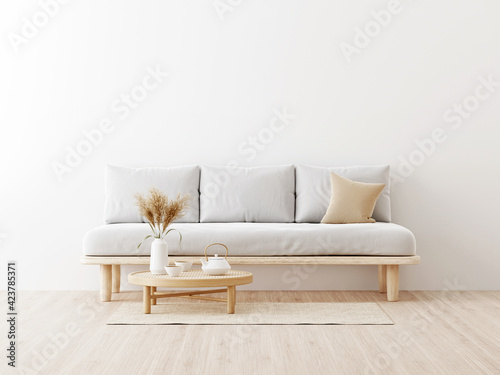 Fototapeta Living room interior wall mockup in warm neutrals with low sofa, beige pillow, dried Pampas grass, caned table and japandi style decor on empty white wall background. 3D rendering, illustration. obraz