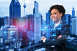 Smiling black woman HR director at international company is thinking about recruitment of highly qualified specialists. Women in business concept. Social media hologram icons over Kuala Lumpur.