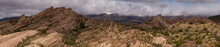 Panorama Of Rock Formations In The Desert Under Moody Skies.