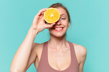 Young Pretty Sport Woman Happy Expression And Holding An Orange