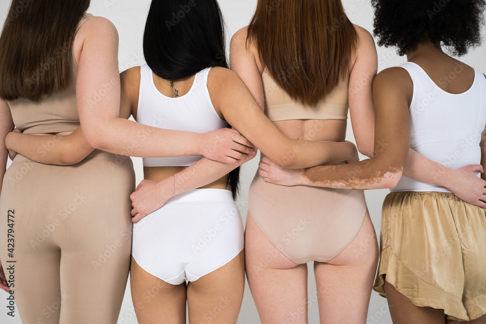 Fototapeta Different girls in underwear embracing in front of the camera