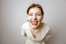 Cartoon Portrait Of A Cheerful Laughing Girl With A Big Head On A Light Background