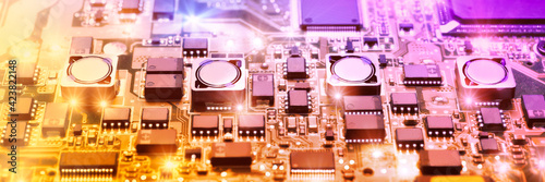 Obraz Closeup on electronic board in hardware repair shop, blurred and - fototapety do salonu
