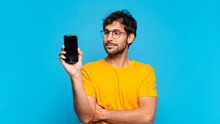 Young Handsome Indian Man Happy Expression And Holding A Mobile Telephone