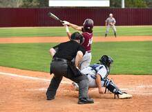 Action Photo Of High School Baseball Players Making Amazing Plays During A Baseball Game